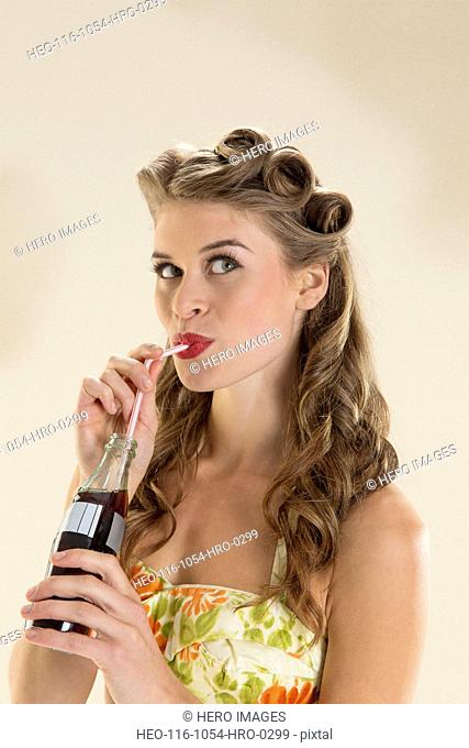 Pin-up girl drinking cola