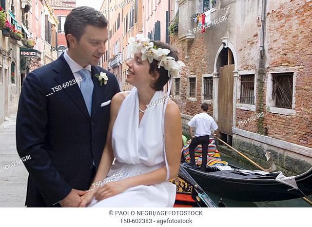 Bride and Groom with background of inner canal and gondola Venice Italy