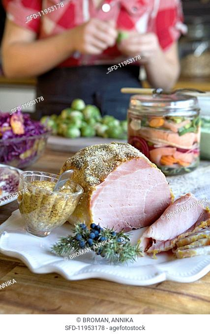 A country style Christmas buffet with ham, mustard and brussels sprouts (Sweden)