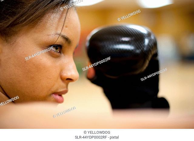 Woman kick boxing in gym