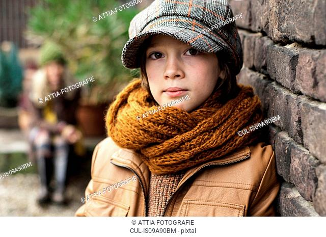 Boy wearing flat cap and scarf, portrait