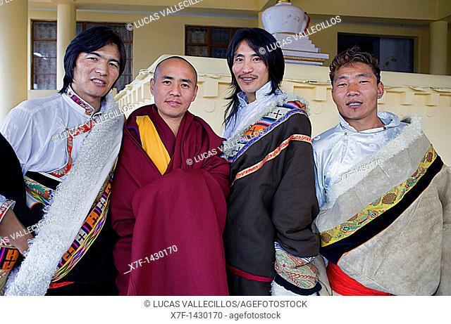 Tibetan wearing typical dress , in Namgyal Monastery,in Tsuglagkhang complex  McLeod Ganj, Dharamsala, Himachal Pradesh state, India, Asia