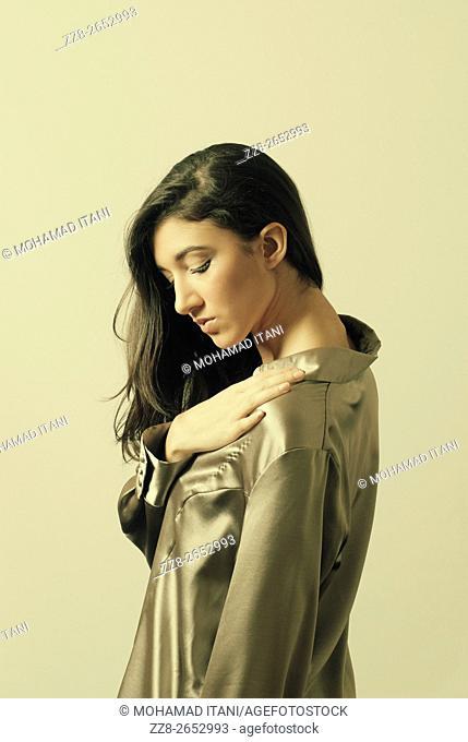 Beautiful young woman hnad touching shoulder
