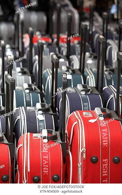 rows of wheeled luggage cases in a row outside a shop in puerto de la cruz tenerife canary islands spain