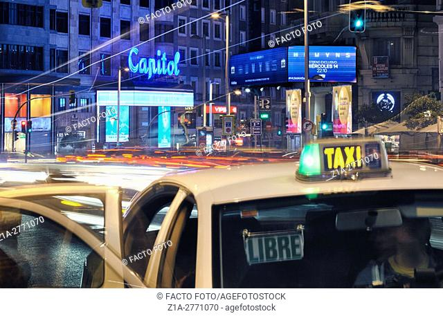 Traffic by night at Gran Via street. Madrid, Spain