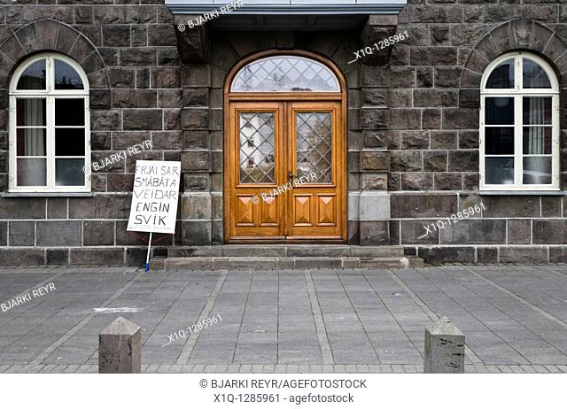 Reykjavik - Iceland, June 9, 2009: A demonstrators sign outside the Icelandic Parliament, Althingi  The sign translates 'Free smallboat fishing, no deceit'