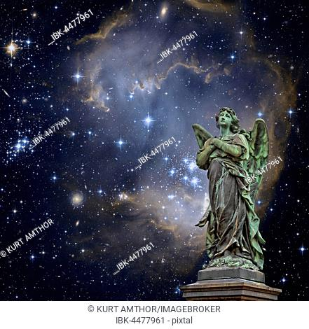Statue of an angel in front of a starry sky, symbolic image for celestial, purity, hope, faith