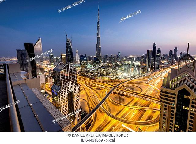 View of skyline from Shangri La Hotel at dusk, illuminated Sheikh Zayed Road, Burj Khalifa, Downtown, Dubai, United Arab Emirates
