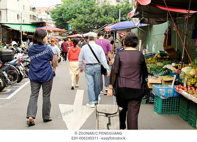 People walk into traditional market