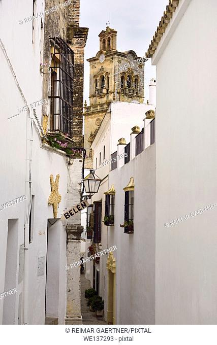 Gold and white buildings on Maldonado street with Saint Peter belfry in Arcos de la Frontera Spain
