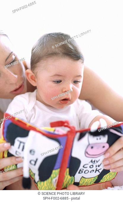 Mother reading to baby boy