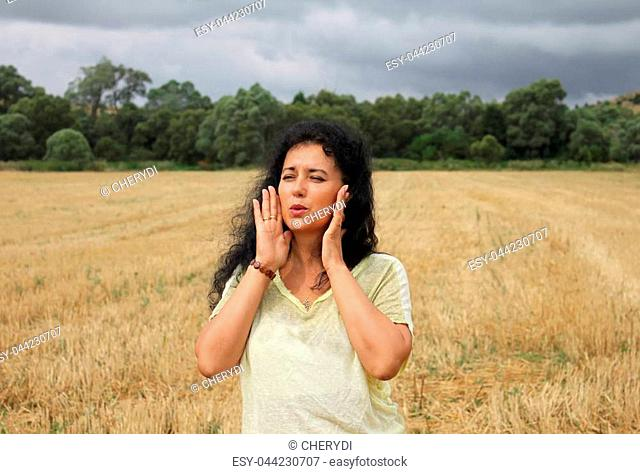 Outdoor portrait of a beautiful woman in a scene on the field