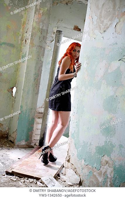pretty redhead girl indoors in ruin