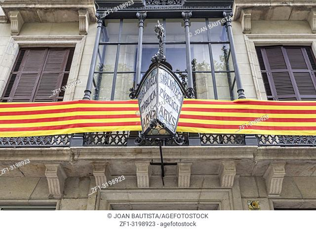 Library Arus, biblioteca, facade building with catalan flag. Study center historic of masonry and liberation movements