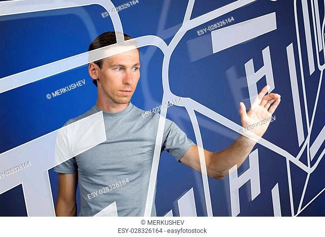 Future technology, navigation, location concept. Man showing transparent screen with gps navigator map. Blue background