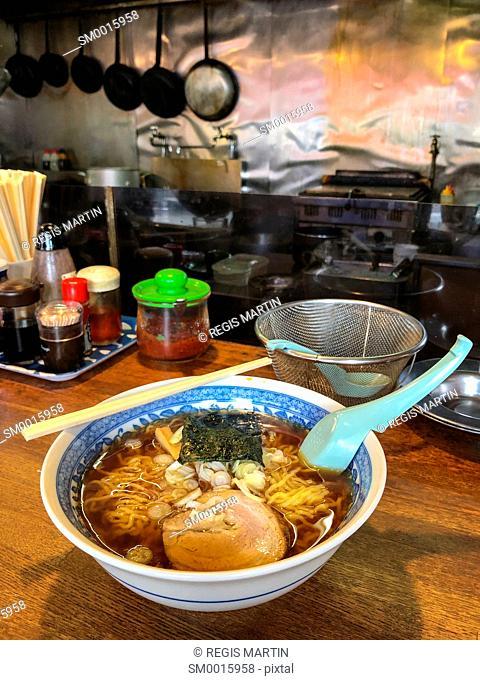 A bowl of ramen noodles soup in a restaurant in Japan