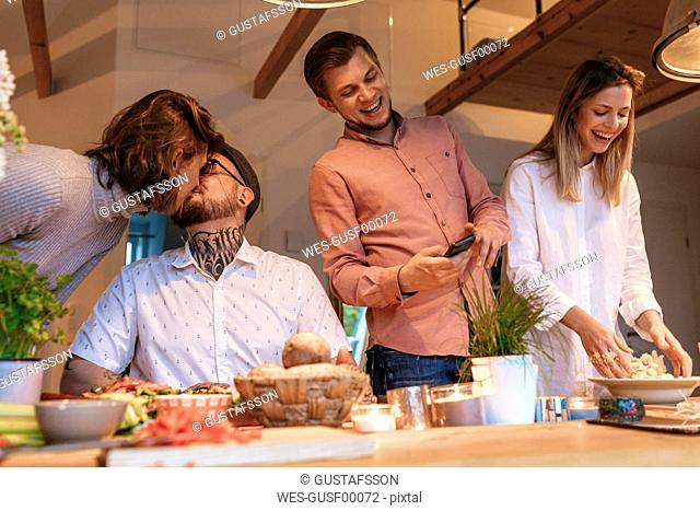 Friends preparing food together at home