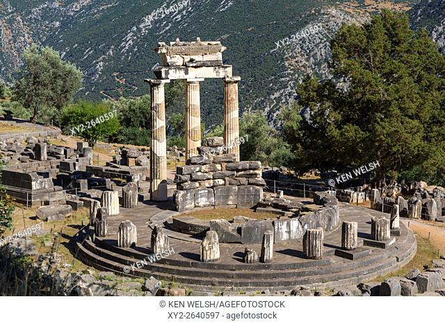 Delphi, Phocis, Greece. The tholos, dating from around 380-360 BC, beside the Sanctuary of Athena Pronaia. Ancient Delphi is a UNESCO World Heritage Site