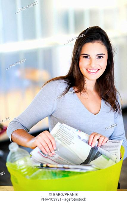 Woman sorting recycled wastes