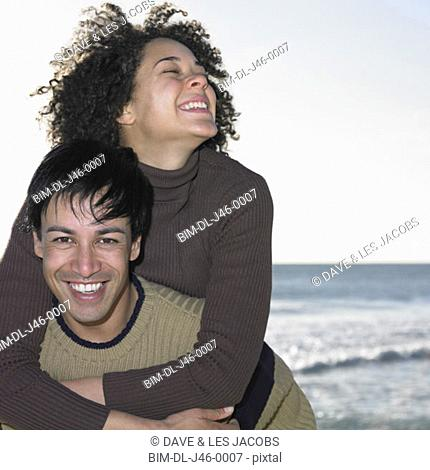 Man carrying woman piggyback