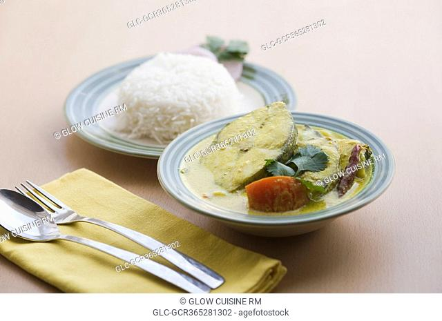 Close-up of fish curry served with rice