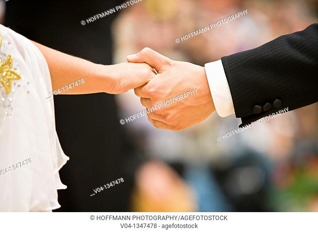 Couple holding hands at a dancing competition, Germany, Europe