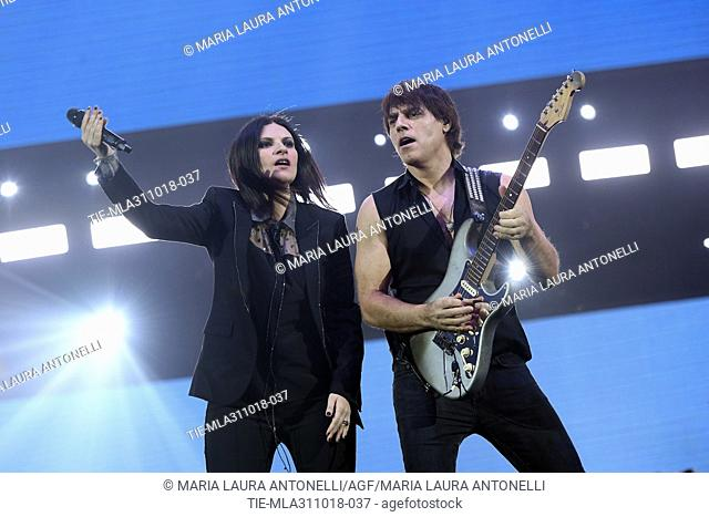 The Italian singer Laura Pausini with partner and guitarist Paolo Carta during the concert, Rome, ITALY-30-10-2018