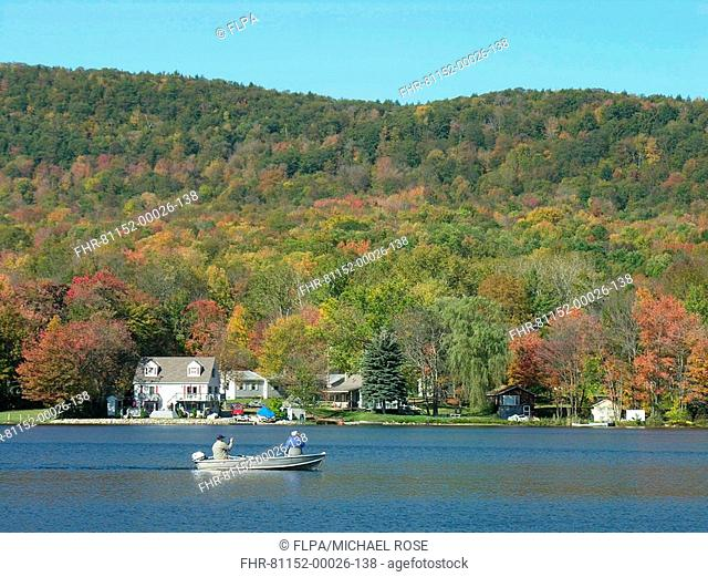 Anglers boat fishing on lake, Vermont, U S A , autumn