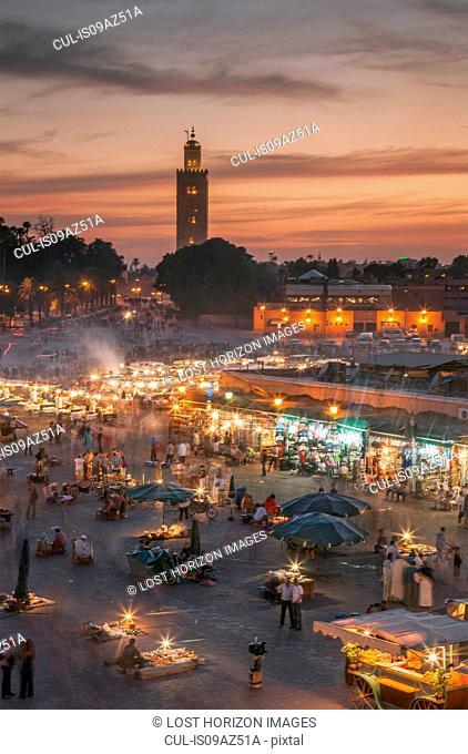 Jemaa el-Fnaa Square illuminated at dusk, Marrakesh, Morocco