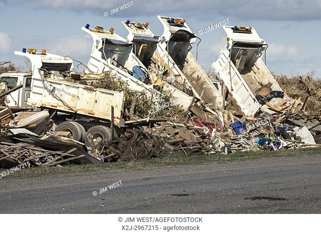 Rockport, Texas - Trucks dump debris from Hurricane Harvey's destruction in the median strip of state highway 35