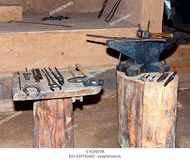 Open-air museum of ancient wooden architecture, smithy interior. Vitoslavlitsy, Great Novgorod