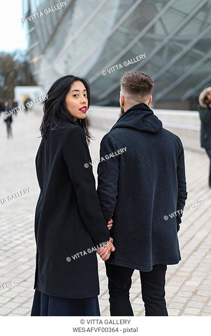 France, Paris, portrait of young woman hand in hand with her boyfriend