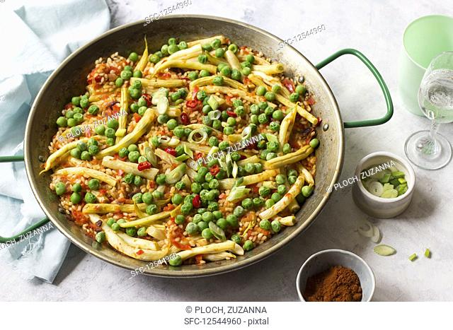 Vegetarian paella, peas, yellow beans, red chillies, spring onion and smoked paprika