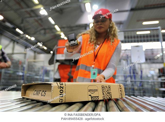 Employee Carol scans a packet in the new Amazon distribution centre in Bochum, Gemrany, 30 March 2017. From here, Amazon Logistics will deliver to several...