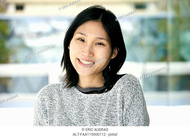 Close-up of smiling young woman