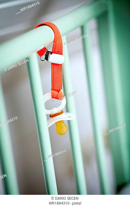 Baby's Pacifier Hanging On Baby Crib, Munich, Bavaria, Germany
