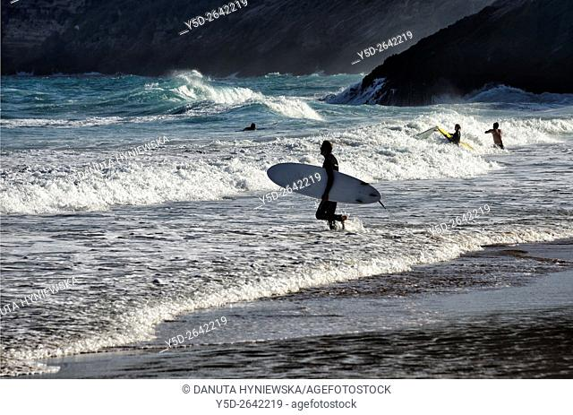 Europe, Portugal, Southern Portugal , Algarve region , Faro district , Sagres, Mareta beach - Praia da Mareta , surfers in waters of Atlantic Ocean