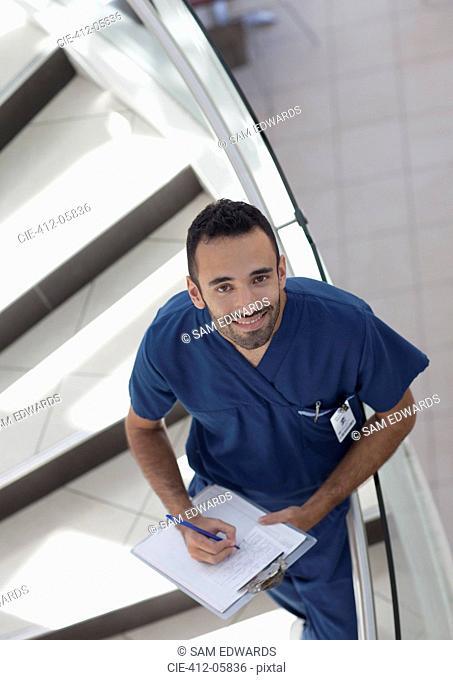 Nurse writing on clipboard on steps