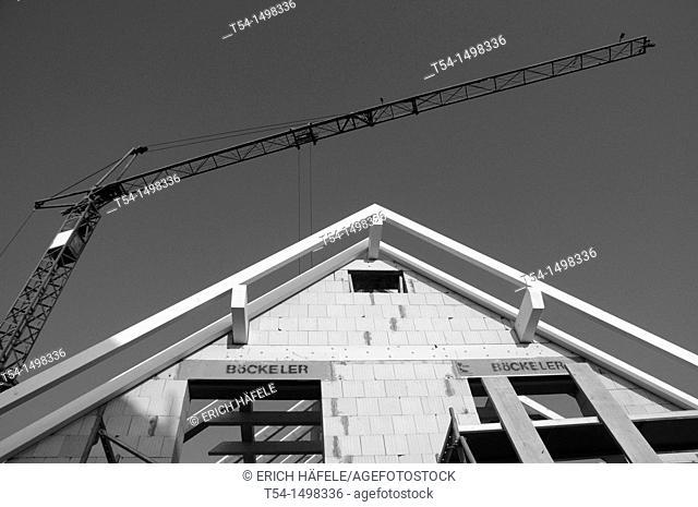 Crane and a newly built house gable