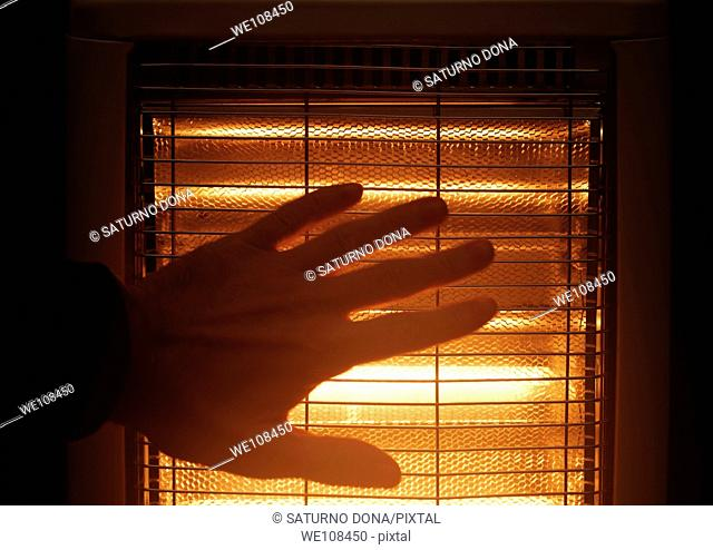 hand next to halogen heater
