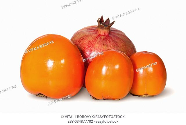 Three Persimmon And One Pomegranate Fruit Isolated On White Background