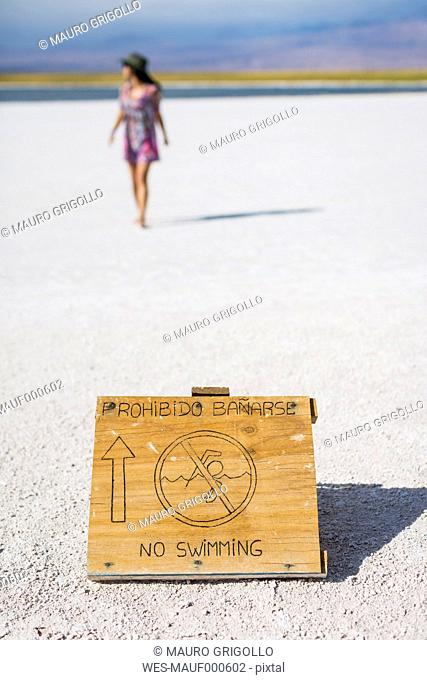 Chile, San Pedro de Atacama, no swimming sign in the desert