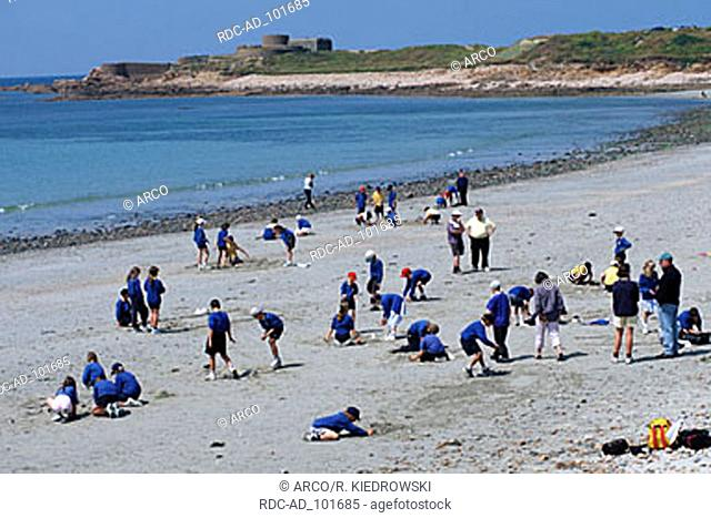 Children playing at beach Vazon Bay Guernsey Channel Islands Great Britain