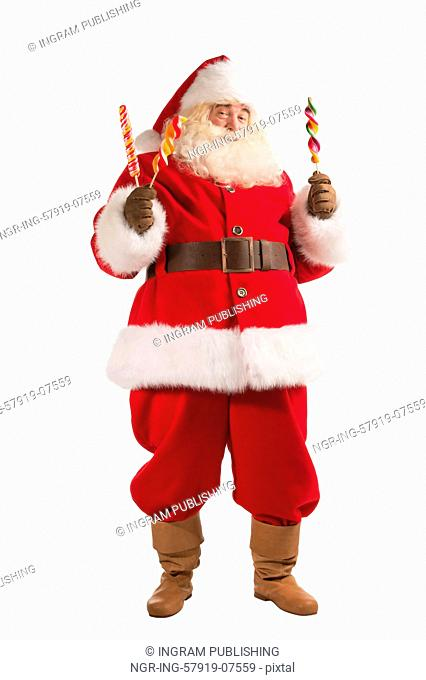 Full Length Portrait of happy Santa Claus holding candy looking at camera isolated on white background
