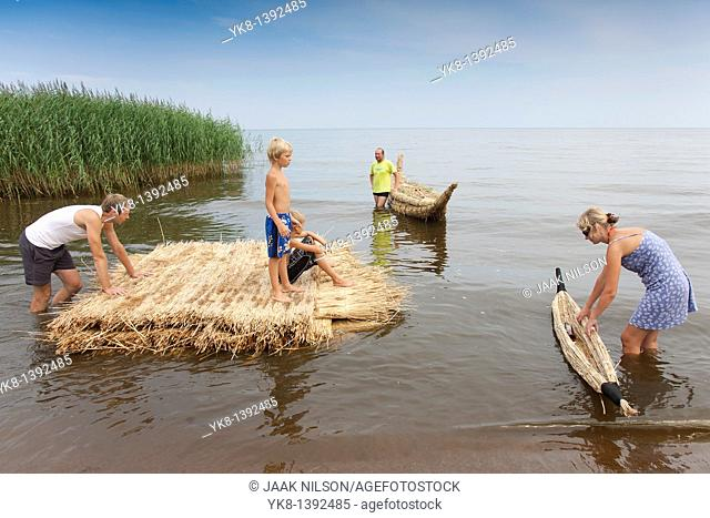 People on Reed Boat and Reed Mat, Lake Peipsi, Estonia, Europe