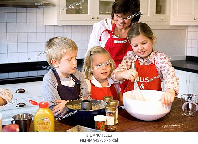 Mother and children baking