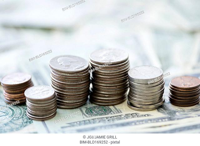 Close up of stacks of coins and money