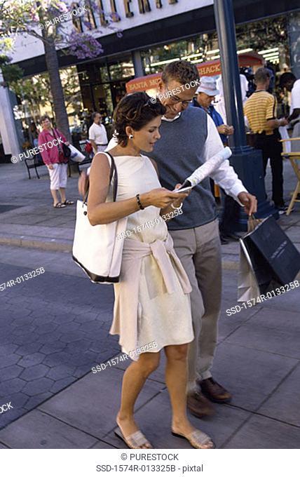 Young couple walking on the sidewalk