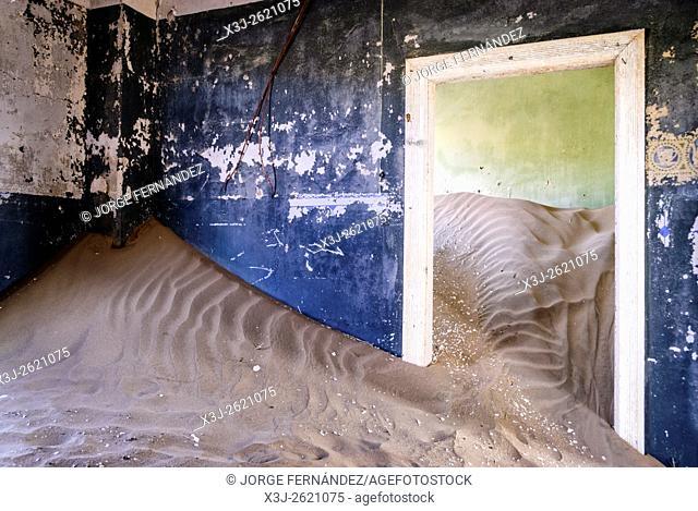 Room of an abandoned house full of sand from the desert