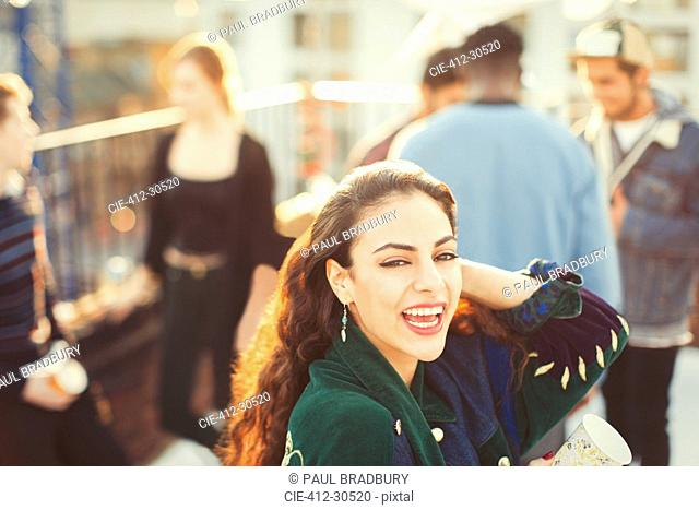 Portrait enthusiastic young woman enjoying rooftop party